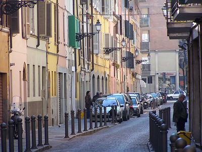 Parma. I like the visual effect of the colored houses and all the shutters