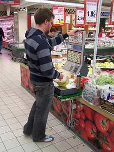 Davy uses the self-service fruit and vegetable weighing machine in a grocery store in Parma