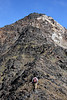 Kelsey moves higher on a ridgeline on Jewel Mountain.