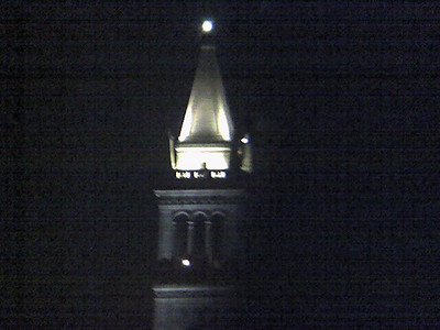 UC Berkeley clock tower, taken with a cell phone camera through binoculars. I can't quite believe this photo worked