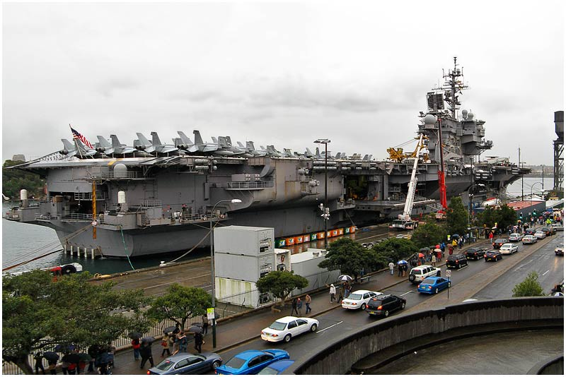 """Garden Island, Monday 9th July 2007.  The USS Kitty Hawk aircraft carrier is in town for several days.   View location on <a href=""""http://maps.google.com/maps/ms?ie=UTF8&hl=en&msa=0&ll=-33.859012,151.203032&spn=0.049108,0.080338&t=h&z=14&om=1&msid=107047001763101043024.0000011385090e2979cca"""" target=""""_blank""""><strong><em>Google Maps</em></strong></a>.    EXIF DATA  Canon A710IS. 1/60s f/2.8 ISO 100."""