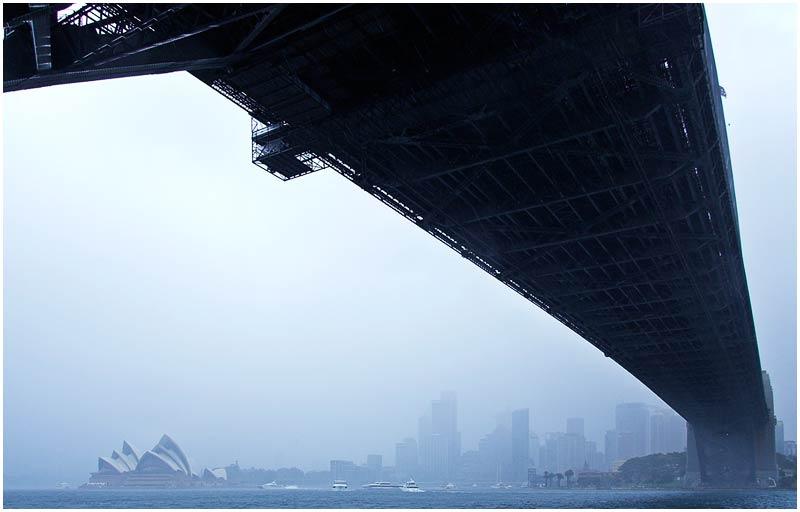 "Sunday 8th July 2007.  Sydney Webcam is taking a break for the month of July. Please enjoy photos from the archives until I return.  Sydney Harbour Bridge (originally taken 4th September 2005).   View location on <a href=""http://maps.google.com/maps/ms?ie=UTF8&hl=en&msa=0&ll=-33.859012,151.203032&spn=0.049108,0.080338&t=h&z=14&om=1&msid=107047001763101043024.0000011385090e2979cca"" target=""_blank""><strong><em>Google Maps</em></strong></a>.  EXIF DATA  Canon 1D Mk II. EF 17-35 f/2.8L@21mm 1/50s f/10 ISO 400."