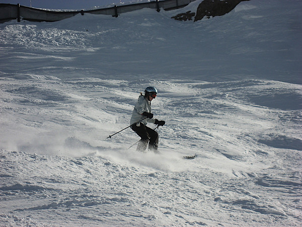 Katy heading down The Wall - look at that powder fly!