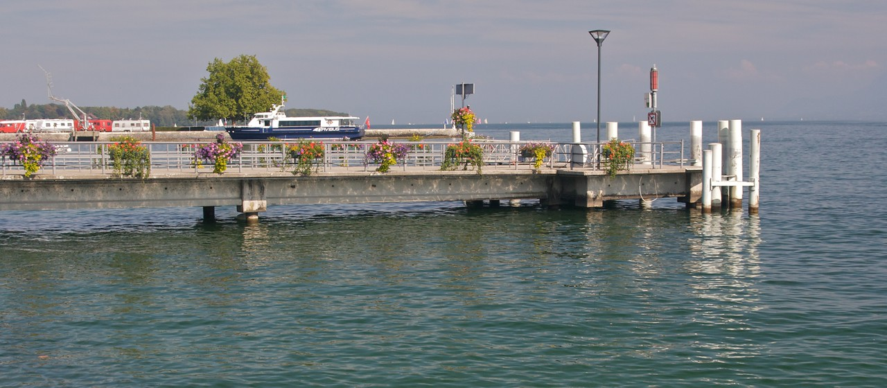 Jetty • A boat sits at a jetty in Nyon, north-east of Geneva on the shore of the lake. The journey between Geneva and Nyon takes ten minutes by train or ninety minutes by boat!