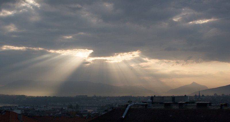 Sunlight streaming in • Morning sunlight streams through the clouds over Geneva. As seen looking south-east from my flat.