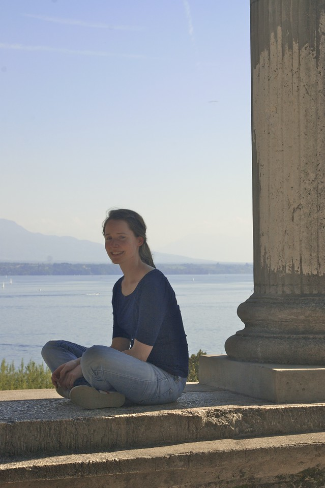 Isobel • Isobel sitting next to the columns in Nyon.