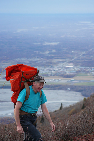 The city of Palmer fades into the background as Dave Clayton walks higher.