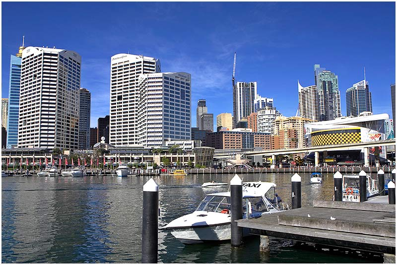 "Darling Harbour, Saturday May 5th 2007. </strong> This image is part of a large panorama and best viewed <a href=""http://sydneywebcam.smugmug.com/photos/popup.mg?ImageID=149609111&Size=Original&popUp=1"" target=""_blank""><strong><em>here</em></strong></a>.  View location on <a href=""http://maps.google.com/maps/ms?ie=UTF8&hl=en&msa=0&ll=-33.862915,151.210949&spn=0.024731,0.040169&t=h&z=15&om=1&msid=107047001763101043024.000001124b2e99a441abd"" target=""_blank""><strong><em>Google Maps</em></strong></a>.   EXIF DATA  Canon 1D Mk II. EF 17-35mm f/2.8L@17mm 1/125 f/9 ISO 200."