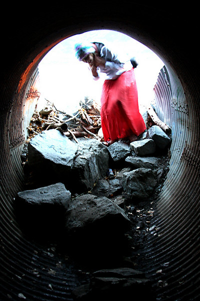 Tracy follows me into a culvert under the Seward Highway.