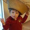 Noam wearing a straw hat
