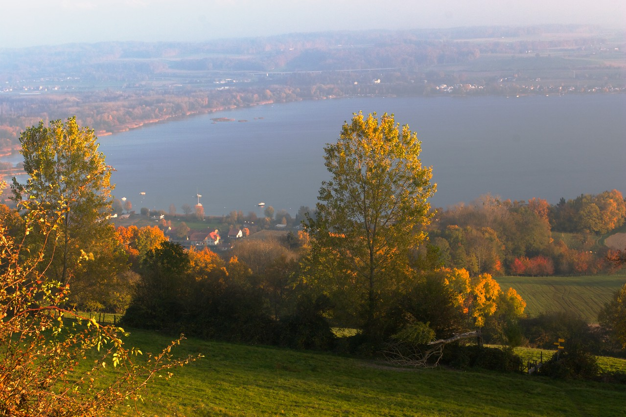 Lac de Morat • Looking towards the Lac de Morat (Murtensee) from the top of Mont Vully; on the other side of the Lake is the town of Murten (Morat in French), formally the first German-speaking town as you move east through Switzerland.