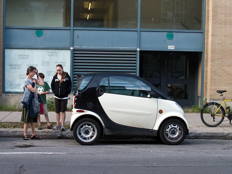 Admiring a Smart car.