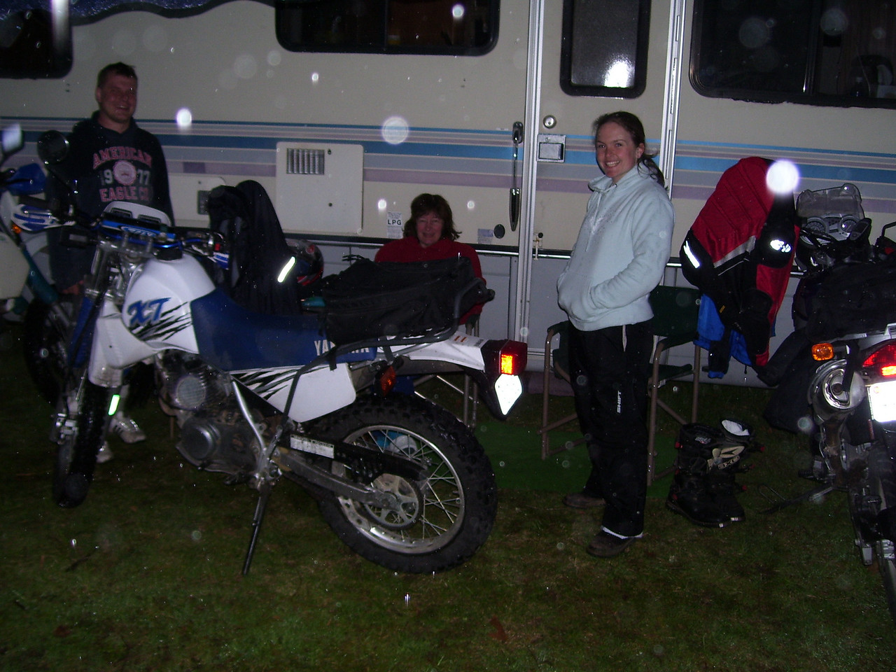 We went 115 miles on Saturday and 88 on Sunday. Kris, Super Syl, and Tarisa under the awning in the rain.