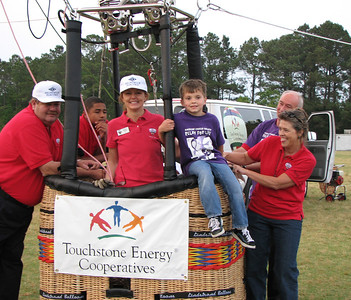Cancer survivor Nicholas Black of Bolivia got a chance to ride in the Touchstone Energy Hot Air Balloon at the 2007 Relay for Life.  Tony Lonbardo of Calabash won the ride and donated the memroable experience to the 6 yr old.  Pilot Cheri White, and Nicholas Black ready for takeoff, surrounded byBEMC balloon team members Earl Andrews, Brook Holmes, Michael Baines and Beryl Hall.