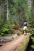 Lina crosses one of the log bridges along the trail.