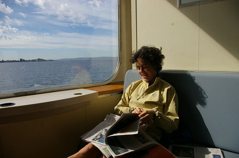 Lina reads the newspaper on the Bremerton Ferry.
