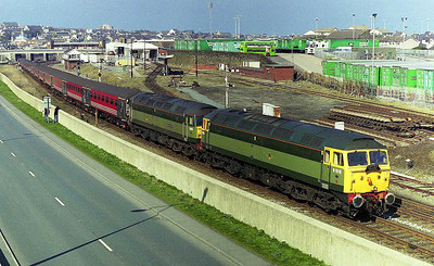 Riviera Trains two-tone green duo 47812+47815 shunt the empty stock into the yard at Holyhead after working forward from Crewe on Compass Tours' 1Z43 0633 charter from Carlisle (24/03/2007)