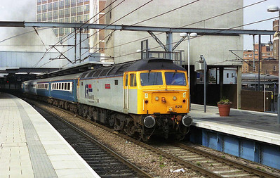 On the other end of the train was 47828 'Joe Strummer', seen here departing Leeds shortly afterwards with the empty stock to Neville Hill. The two locos had worked in multiple as far as York, where '813 had been run-round (31/03/2007)