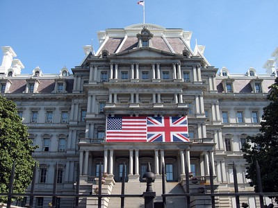 The American flag and the Union Flag displayed at the Dwight D. Eisenhower Executive Office Building.