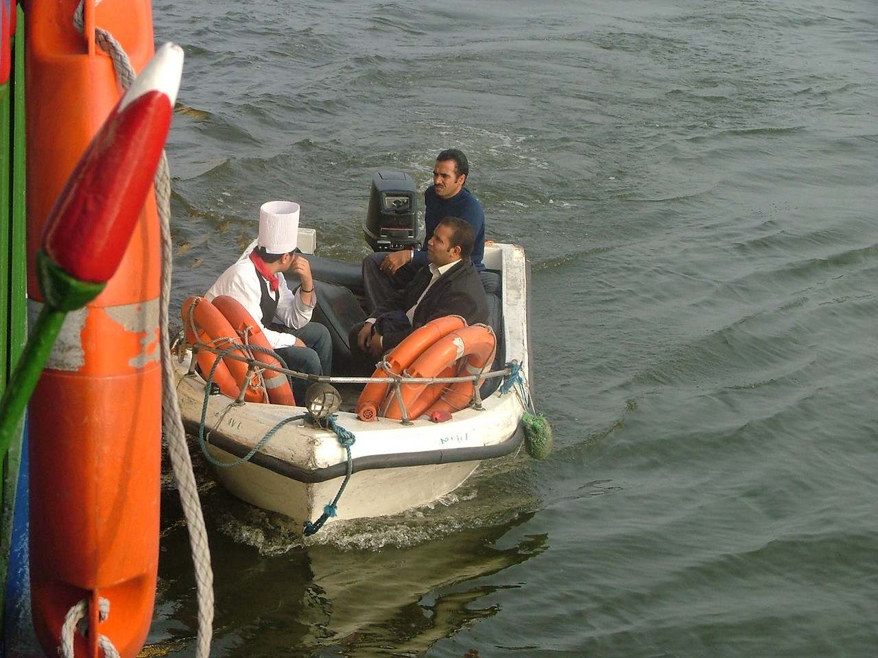 Not sure what this was, but the small boat came up to our boat, and the cook got off.  Late for work?