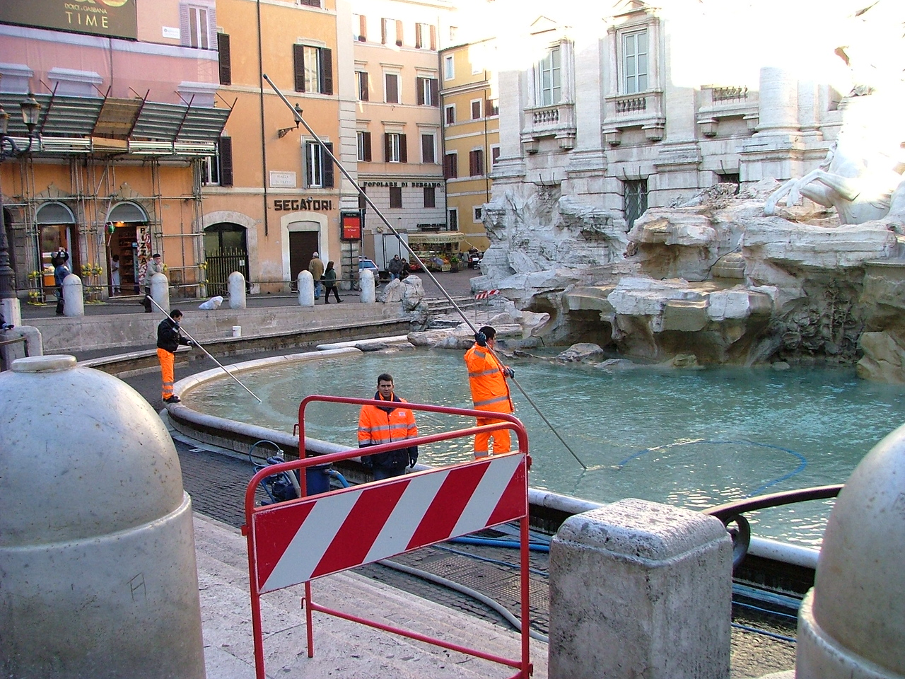 Cleaning out the coins from Trevi Fountain