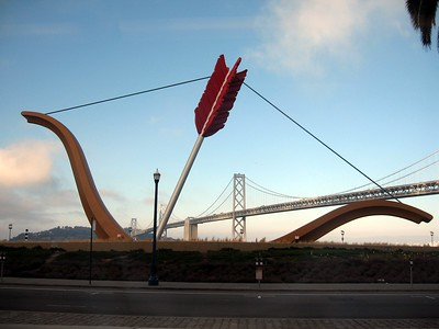 Cupid's Span, by Claes Oldenburg and Coosje van Bruggen, in Rincon Park.  In the background is the San Francisco-Oakland Bay Bridge.