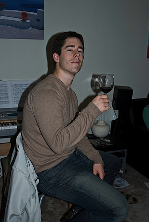 Andrew is all sophisticated since he is drinking wine