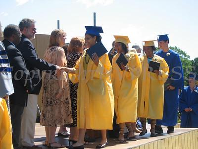 Graduates receiving diplomas