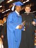 Graduate receives his diploma