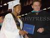 Graduate receives her diploma