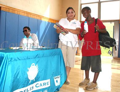 Fidelis Cares' Julissa Ocasio gives Trevor Joyner Jr a waterbottle