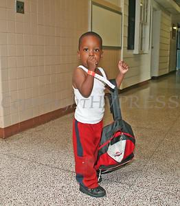Xavier McLean shows off his new bookbag