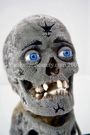 Steven Gregory--Bearing in Mind, 2007<br /> Human skull, stainless steel ball bearings, glass and Russian jet