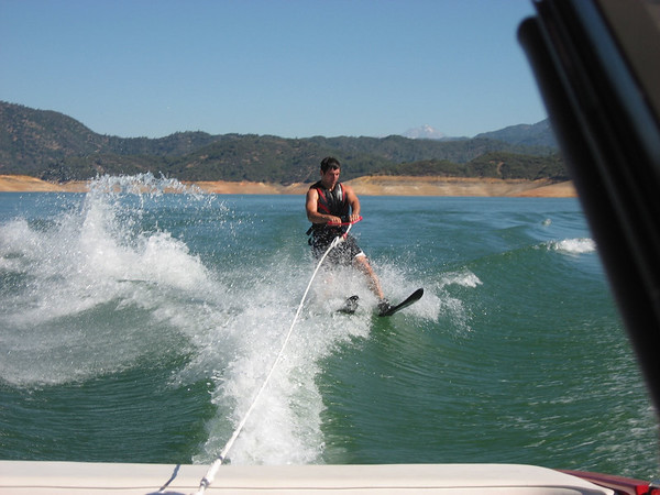 Aaron going over the wake while water skiing. I think he's about to take a tumble.