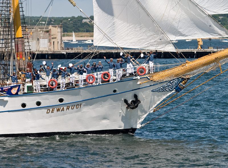 "The bow of the ""Dewaruci"", with sailers waving their caps."