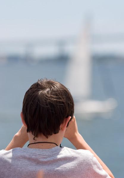 Benjamin watching a yacht.