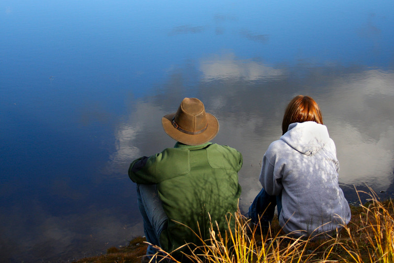 Richard and Liz enjoy the peace and quiet of a small pond on a quiet autumn evening.