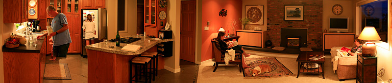 """This is a panorama inside my parent's house. Click on """"Original"""" image size and scroll to the right. It is a >180 degree view, composed of 12 separate images. (I used the Photoshop CS3 """"align and merge"""" feature - on 12 separate 12 megapixel images at once! Yes, it took awhile.) You will notice that my Dad's legs are missing - he moved before I had swung back around for the second pass of photos. I am missing the view behind me - a picture window looking out on the Sound, and their new entry vestibule (very cool.) I will do a 360 view next time I am there."""