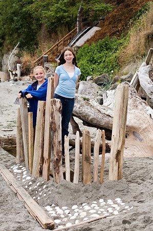 "Ilana, Emily and Elena loved making ""fort sculptures"" on the beach in front of Dad's place."