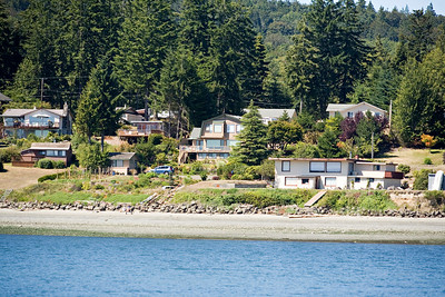 "This is looking back at Dad's house from the little ""seal island"" that we rowed to. (His is the big place in the middle, with all the windows.)"