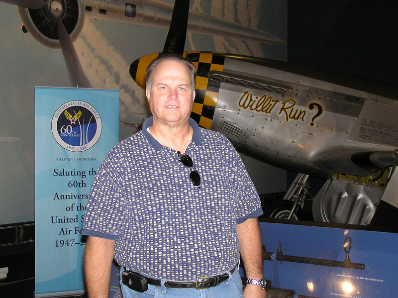 Mike next to his favorite airplane, P-51 Mustang (Cadillac of the Skies)