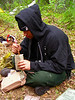 Andy Zola enjoys his MRE in camp.