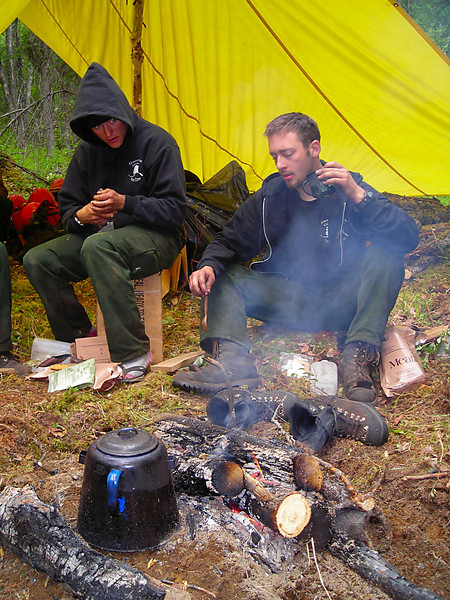 Our fire camp was fairly well furnished, with a communal rain shelter and a campfire.  Sarah Quimby and Jeremy Mothershead dry off and get warm.