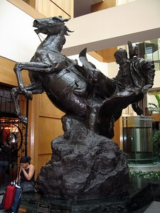 Slicker Shy, by Herb Miignery, in the lobby of the Adam's Mark hotel.  The Adam's Mark is the largest conference hotel in Texas and the eighth largest in the United States.