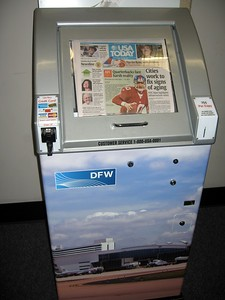 A newspaper machine that takes credit cards, at Dallas-Ft. Worth International Airport