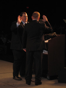 Outgoing president Chris Gallaway administers the oath of office to incoming president David Hardt