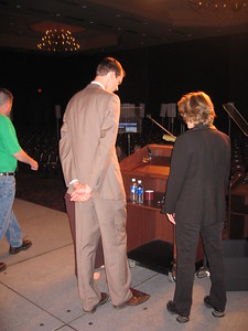 Rod Snyder rehearses using the teleprompter to make a speech nominating Amy Lewis for Treasurer.