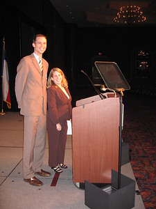 Rod Snyder and Amy Lewis, the tallest and shortest convention speakers, help set up the teleprompter.