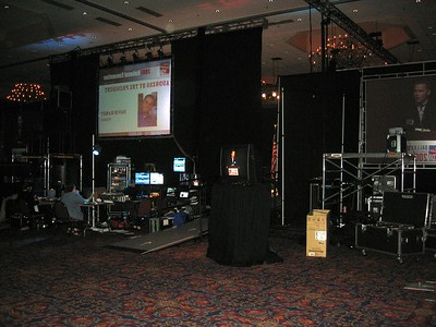 Backstage during the address by incoming president David Hardt.  The stage (with the American flag) is visible through the drapes.
