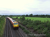 211 slows for the Portarlington stop with the 1735 Limerick - Heuston.  Sat 11.08.07